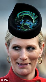 DAY TWO: A modern pillbox perched on the front of the head with a curled peacock feather