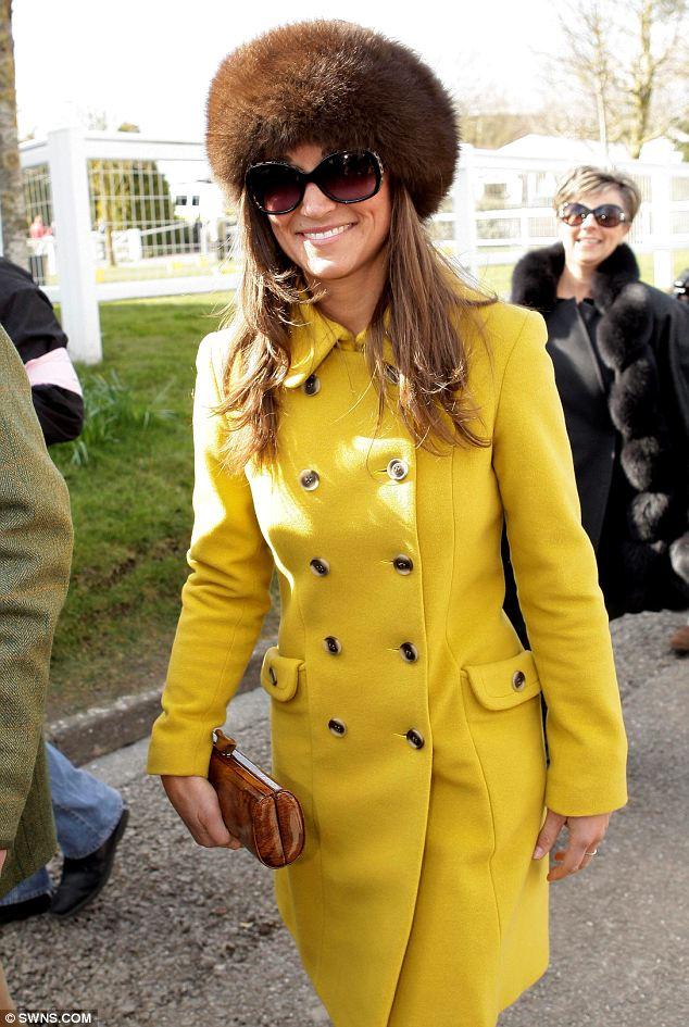 Pippa Middleton arrives at Cheltenham races wearing a bespoke Katherine Hooker coat and a huge smile