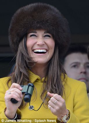 Pippa Middleton watches the racing at Cheltenham Festival