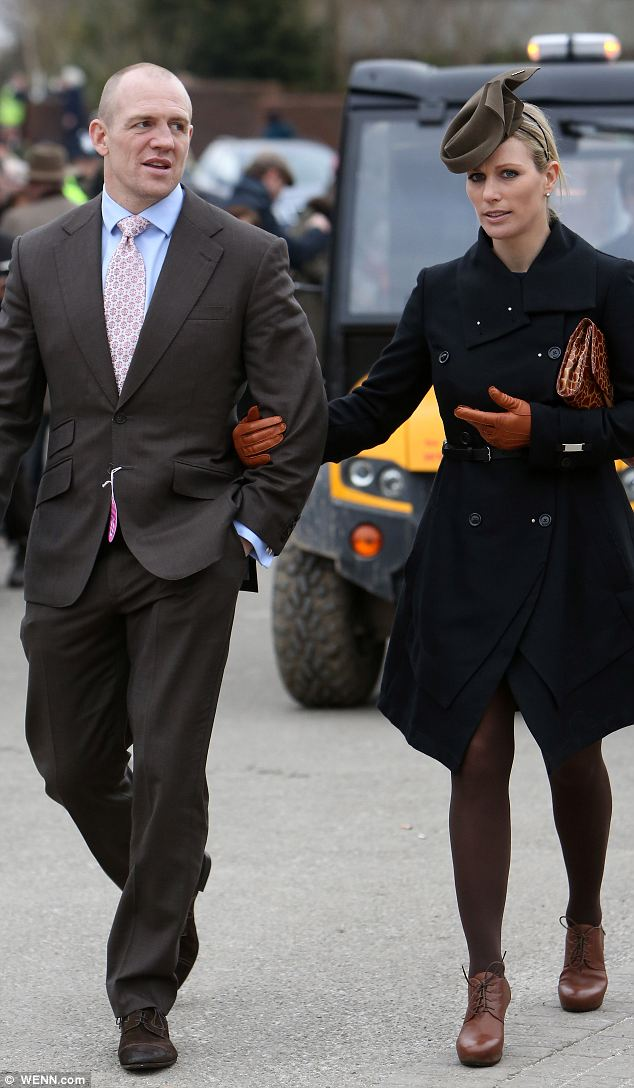 Zara Phillips and husband Mike Tindall arrive for the third day of the famous race meet
