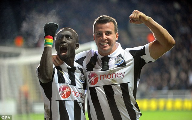 Last-gasp: Matchwinner Papiss Cisse celebrates his late goal with team-mate Steven Taylor