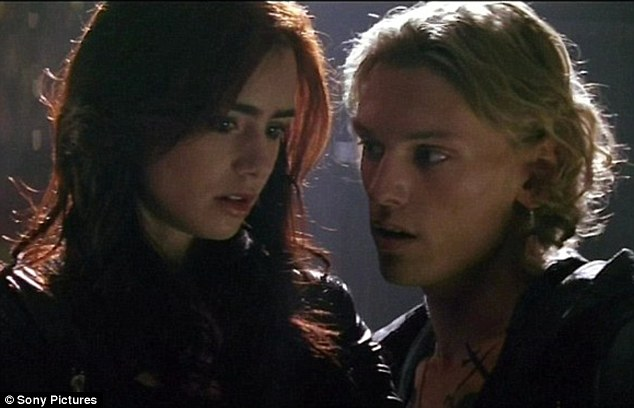 Going into battle: Lily Collins and Jamie Bower Campbell in The Mortal Instruments: City of Bones.