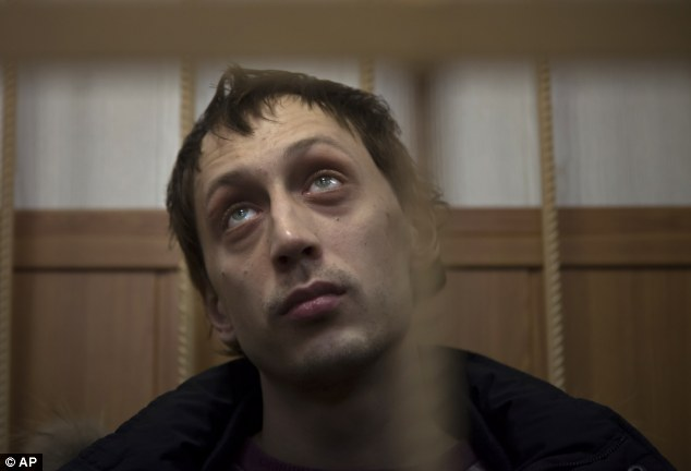 Confession: Bolshoi soloist Pavel Dmitrichenko, pictured in court last week,  has admitted to 'giving his blessing' to a physical attack on Filin but not that the perpetrator would use acid
