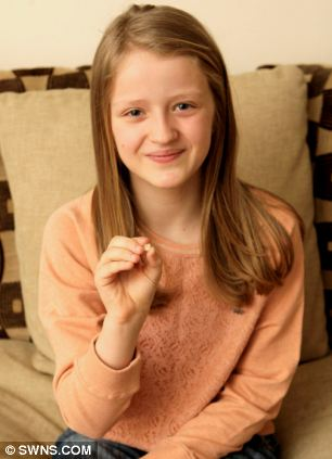 Trina Hutchinson got £2 from the tooth fairy for her molar which had a smiley face on it