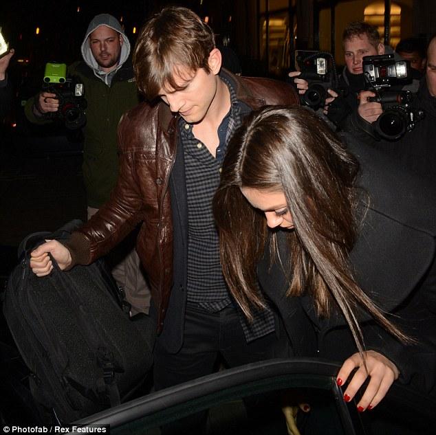Back on boyfriend duty:  Ashton Kutcher and Mila Kunis