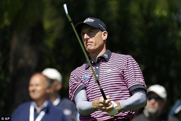 Eagle eyed: American Jim Furyk tees off on the eighth hole during the first round of the Tampa Bay Championship