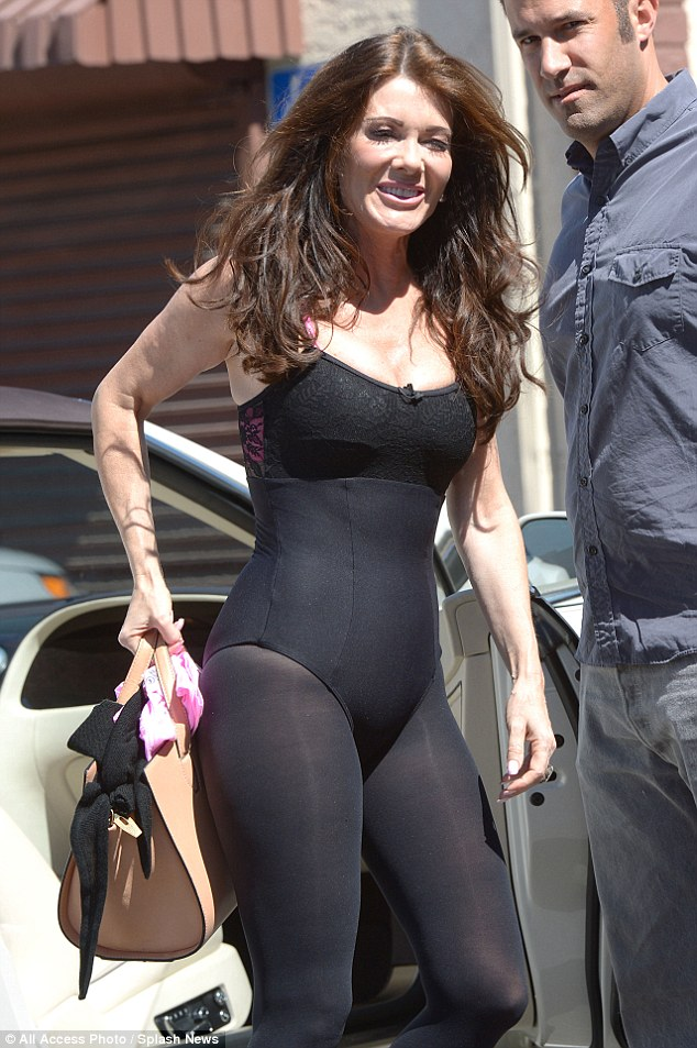 Flash dancer: Lisa Vanderpump borrowed a look from Flashdance as she headed to rehearsal on Dancing with the Stars on Thursday in a clingy leotard and tights