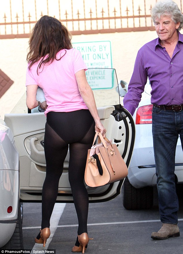Let's hotfoot it! Lisa later left in a pink T-shirt - but with her derriere on show