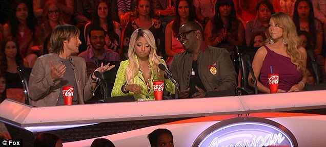 Deciding his future: Nicki looked like she was sulking as Randy Jackson and Keith Urban had an intense discussion on either side of her