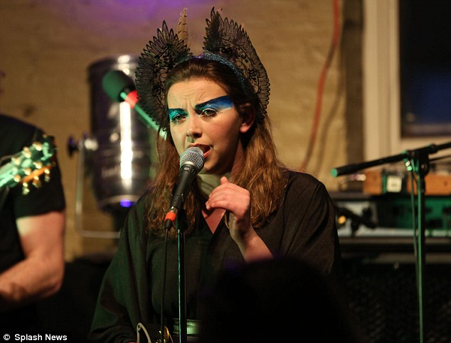Eccentric ensemble: The Welsh songstress appeared to have opted for a bizarre bat-inspired headpiece as she took to the stage