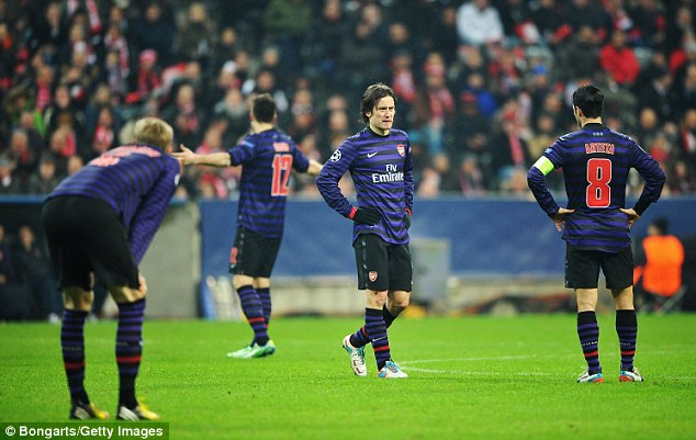 Out: Despite winning 2-0 in the Allianz Arena, Arsenal crashed out to Bayern Munich on away goals