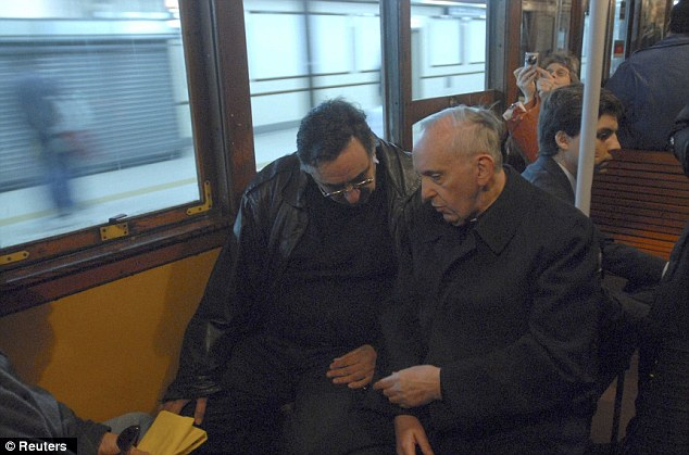 History: Argentine Cardinal Jorge Bergoglio (R), now Pope Francis, is pictured travelling by subway in Buenos Aires