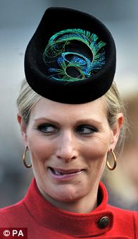 She wore a modern pillbox finished with a bright peacock feather for day two
