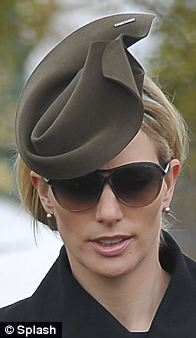 For Ladies Day the royal wore a khaki design by Karen Henriksen and designer sunglasses