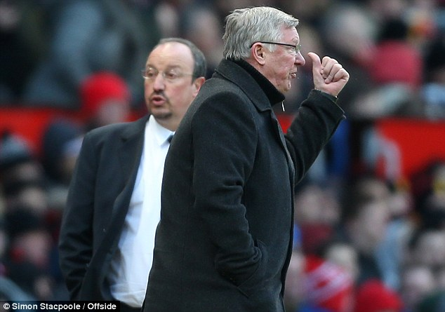 Clash: Sir Alex Ferguson (right) and Rafa Benitez on the touchline on Sunday