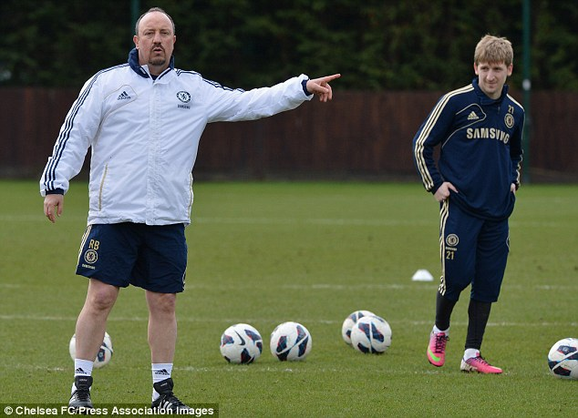 Pointing the way: Benitez takes charge of Chelsea's training session on Friday
