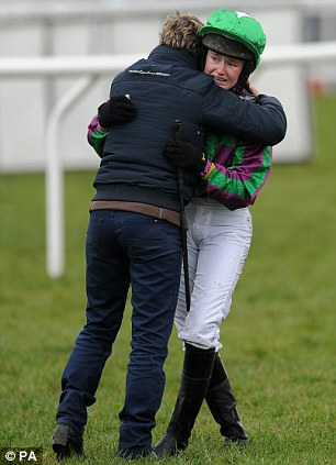 There, there: Mangan is consoled after bowing out of the Foxhunter Chase with victory in sight