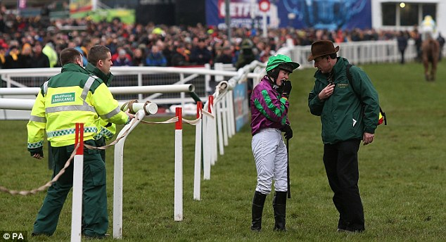 Just her pride that's hurt: Mangan just seconds after the fall that cost her victory in the Foxhunter Chase