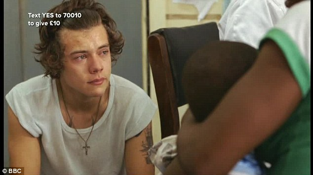 Teary-eyed: Harry couldn't help but hold back the tears as he met babies