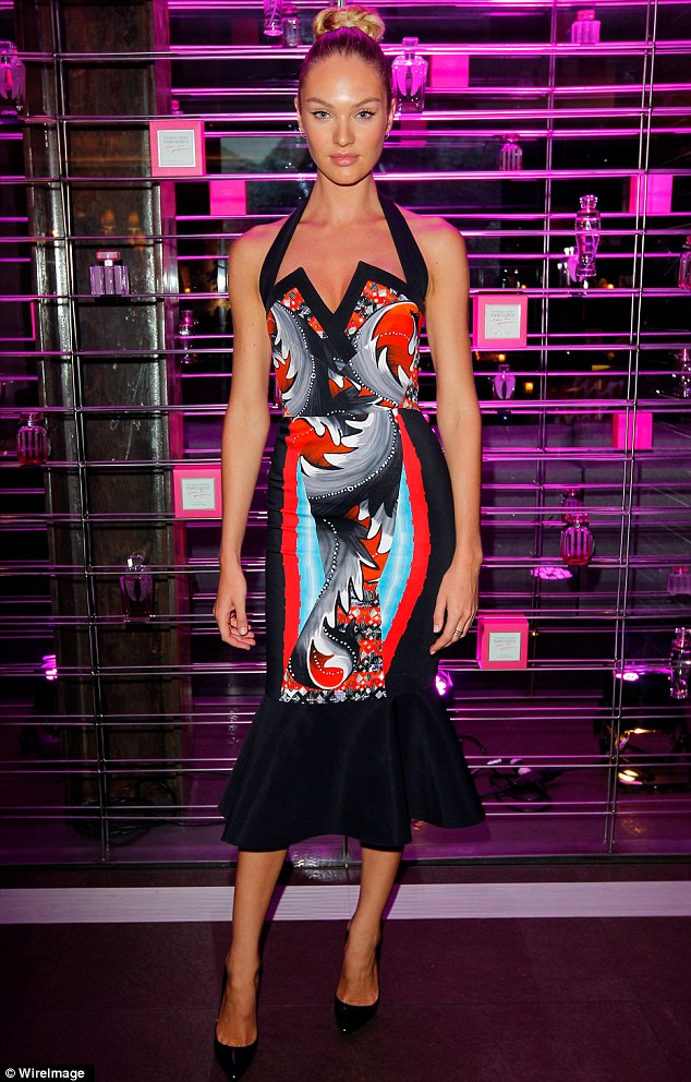 Stunning: The 24-year-old looked stunning in her colourful ensemble as she attended the Victoria's Secret 2013 Swim Party on Tuesday night
