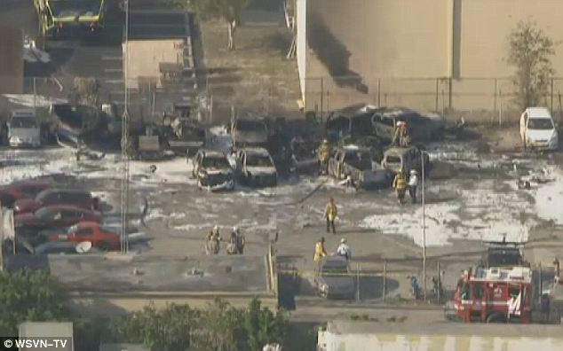 Serious damage: A small plane crashed into a warehouse and landed in the parking lot killing all three passengers