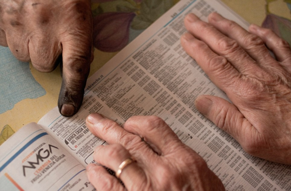 Happily married: This picture shows the couple, both 85, looking through the phone-book. Licia's wedding band is pictured