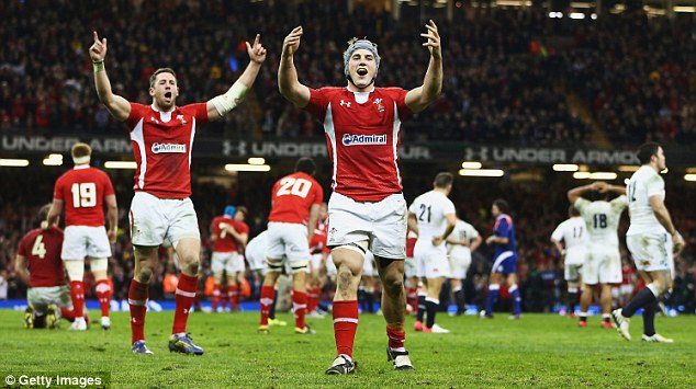 Triumphant: Wales celebrate their stunning victory over England which saw them win the Six Nations title