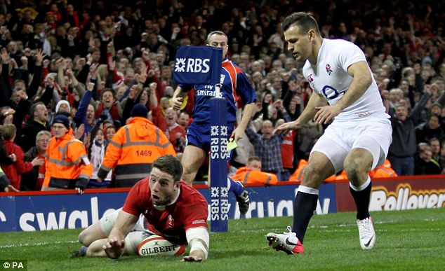 Matchwinner: Alex Cuthbert scored both of Wales' tries as England were put to the sword in Cardiff