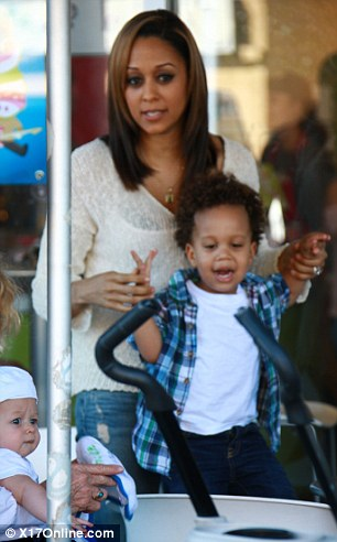 Playtime: Cree danced around on a chair with his mom Tia