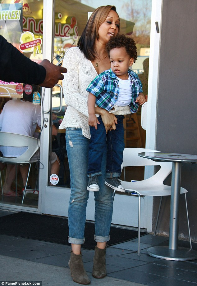 A handful: The two-and-a-half year old is almost getting too big for his mum to carry