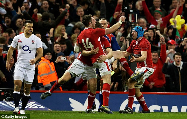 Start the party: Alex Cuthbert's second try sparks jubilant scenes with teammates Dan Biggar (left) and Justin Tipuric