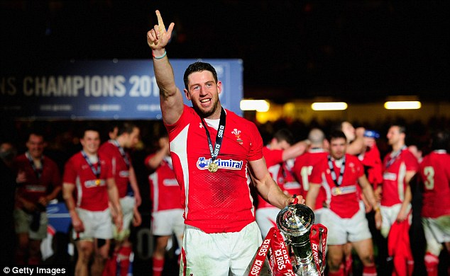 Make mine a double: Two-try hero Alex Cuthbert celebrates with th Six Nations trophy after Wales crushd England to win back-to-back titles