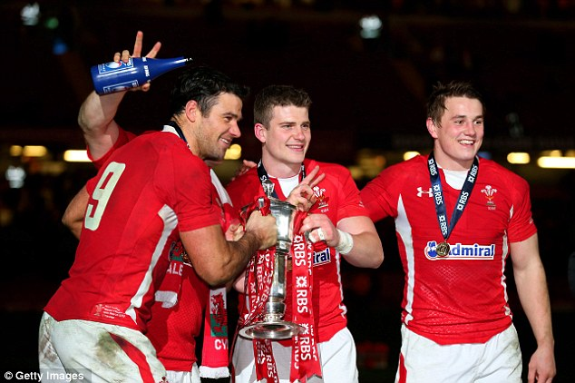 On the up: Mike Phillips, Scott Williams and Jonathan Davies pose