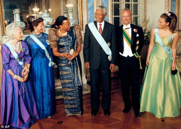 Always smiling: Princess Lilian, the King and Queen and Crown Princess Victoria pose for photographers with President Mandela and his wife Graca Machel in 1999