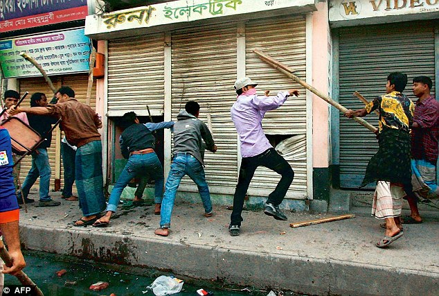 Islamist activists vandalize shops during clashes with police in Bangladesh on March 3