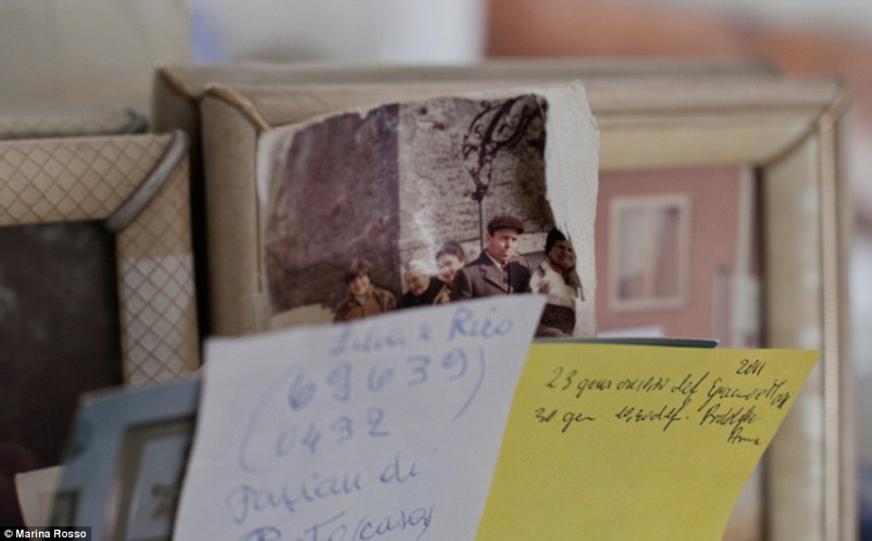 Memories: Family photos and images from the couple's youth are captured around the home interspersed with more practical notes and lists
