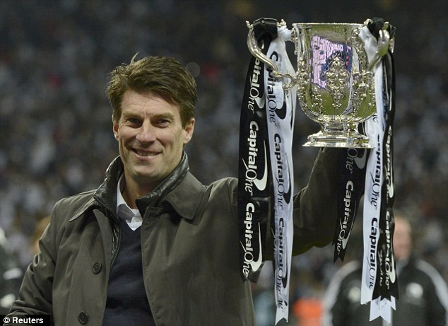 Unforgettable season: Laudrup has continued Swansea's rise this year, establishing them as a mid-table side and winning the Capital One Cup
