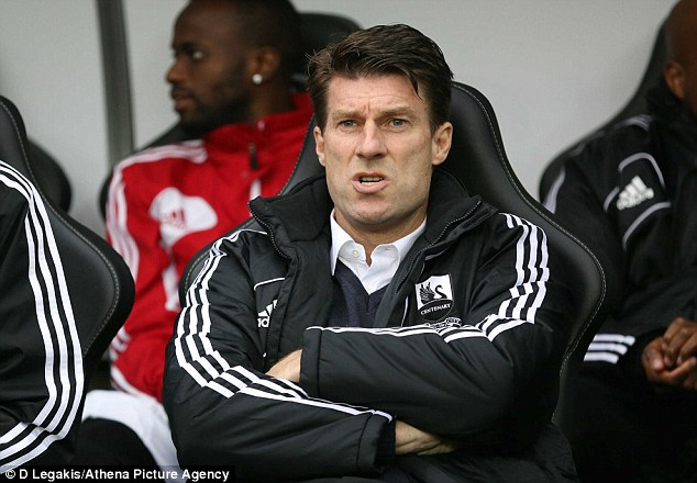 No attitude problem: Swansea boss Michael Laudrup was forced to answer questions about his team's commitment following the 2-0 home defeat to Arsenal on Saturday