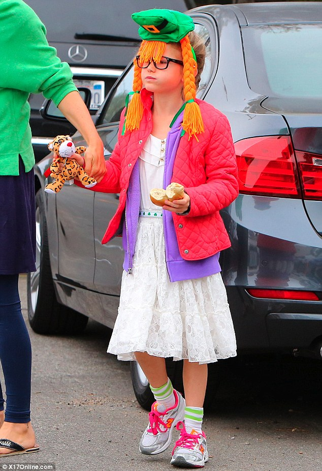 Where's her pot of gold? Eight-year-old Violet was particularly festive for the holiday with her headband of a Leprechaun's hat and pigtails