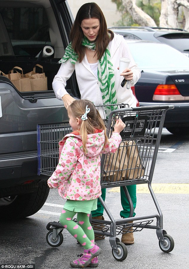 Mummy's little helper: Thoughtful Seraphina made sure the trolley did not roll away as Jen loaded the boot