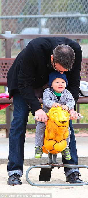 Ben-d over: The actor showed his flexibility as he helped the youngster have a ride on a rocker