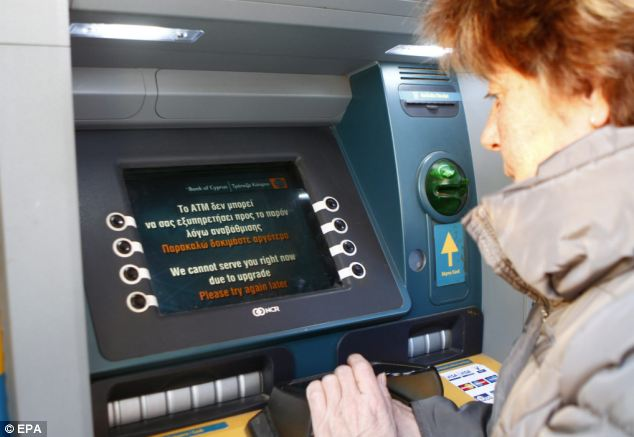 A woman attempts to withdraw from an ATM