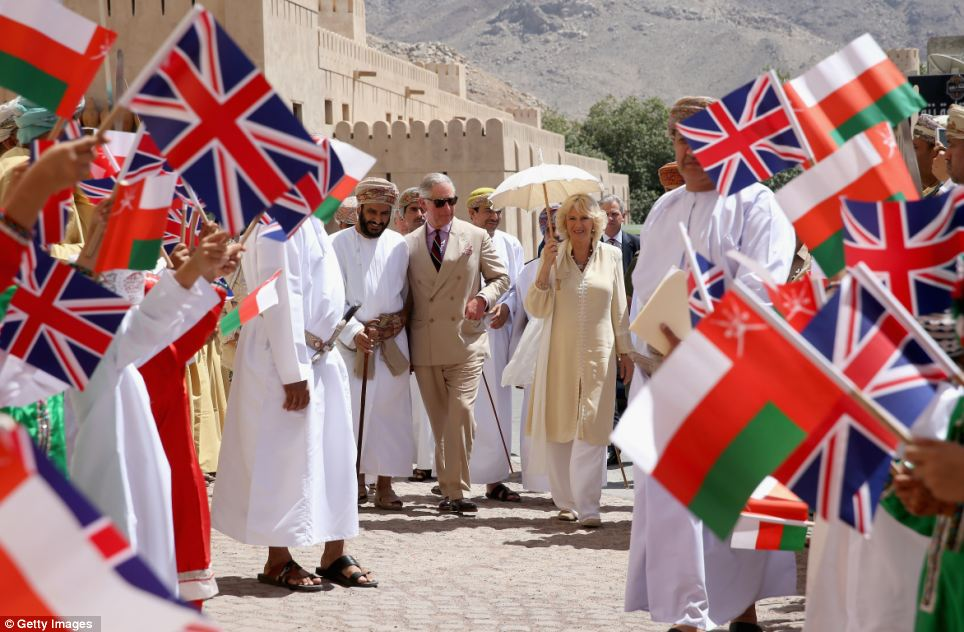 Warm welcome: As the royal couple toured the stronghold they were greeted by children waving Union flags and met people who were making mats and baskets