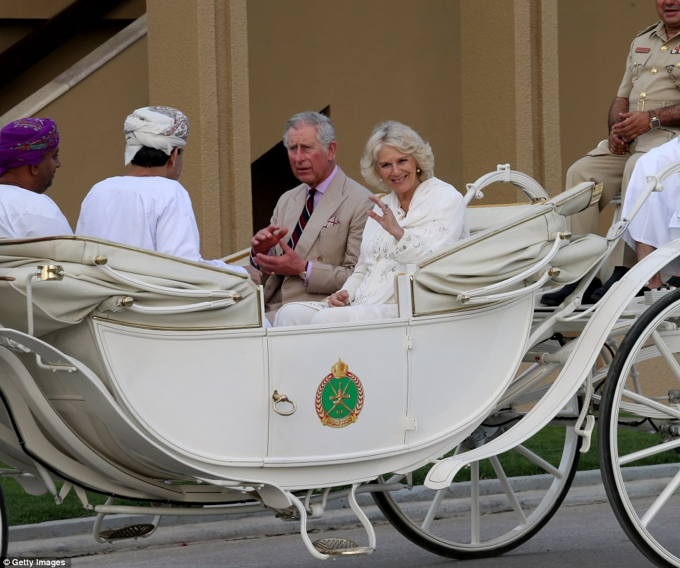 Royal greeting: Prince Charles, Prince of Wales and Camilla, Duchess of Cornwall arrive at a cavalry event on the eighth day of a tour of the Middle East in Muscat, Oman