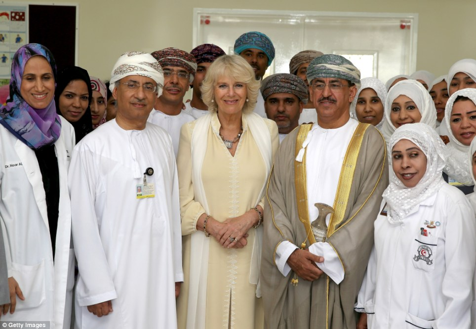 Happy to help: Camilla, Duchess of Cornwall poses with doctors and staff at the Royal Hospital in Muscat earlier today