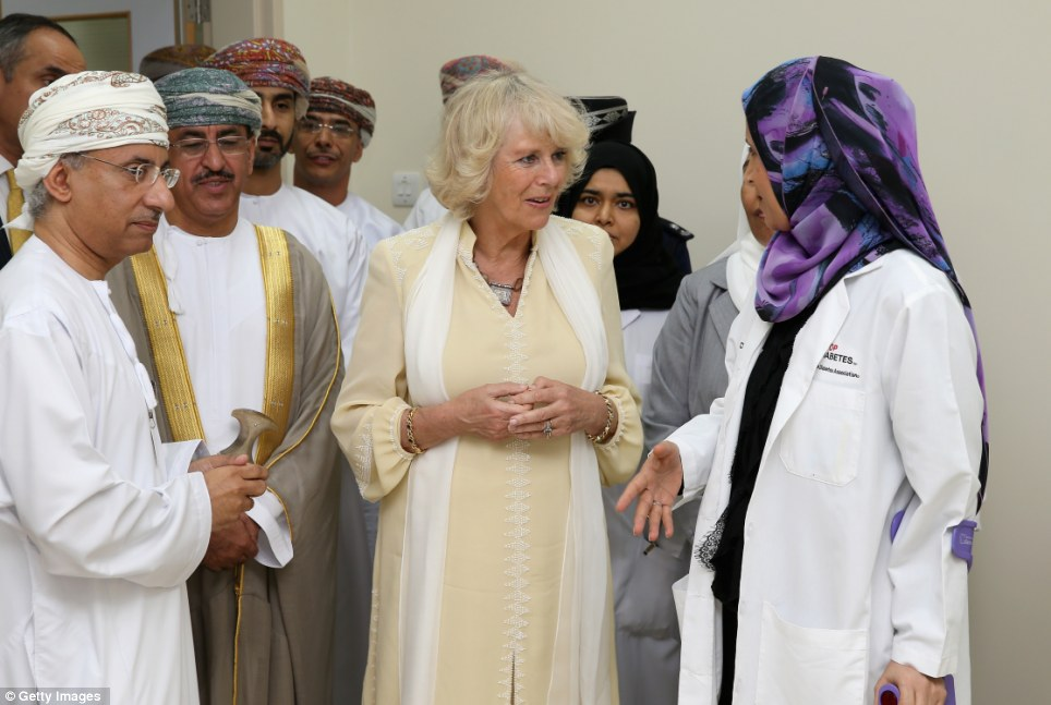 Keen interest: Staff at the Royal Hospital in Muscat chat to Camilla about their work with diabetes patients during her Monday visit