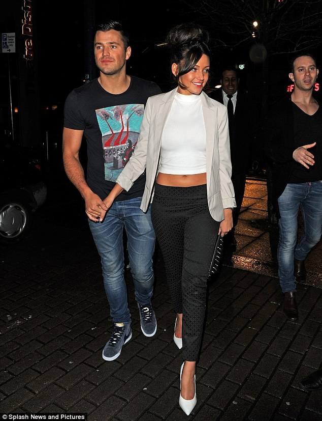 Retro style: Michelle Keegan embraced 1960s chic in a crop top and cigarette pants as she headed out in Milton Keynes with Mark Wright on Sunday night