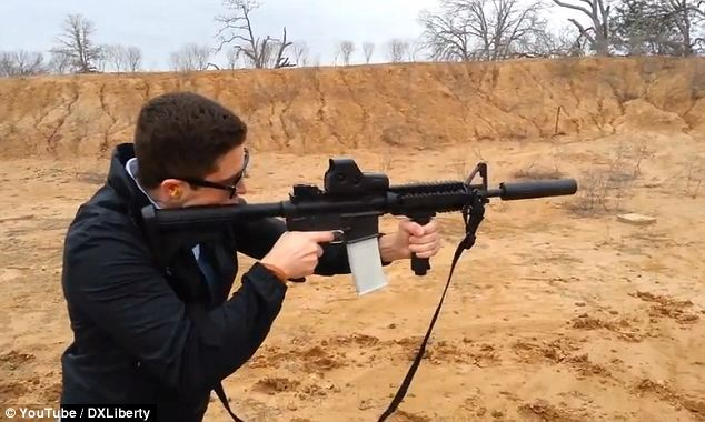 Free to download: Cody Wilson, founder of Defense Distributed, tests out a 3D-printed magazine for an AR-15 semi-automatic rifle. He has now been granted a license to make and sell guns