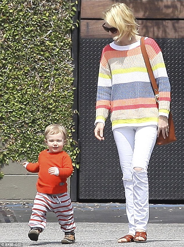Keep up mommy! January Jones's son Xander raced ahead of his mother as they left lunch in Pasadena, California on Monday