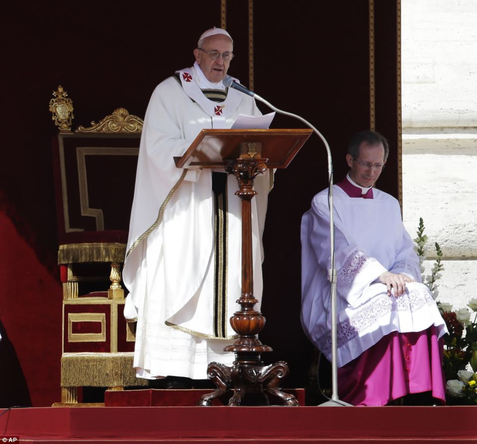 Pope Francis reads the gospel during his inaugural Mass in St. Peter's Square at the Vatican, Tuesday, March 19, 2013. (AP Photo/Gregorio Borgia)